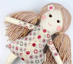 camille is a one of a kind handmade rag doll with lots ofsoft beige colored wool yarn hair and hand embroidered smiley face. she wears grey pinstriped tall socks and has light pink felt rosy cheeks... a perfect friend for cuddles, tea parties, and secret sharing. * MADE TO ORDER * orders typically ship within 1-2 weeks * small changes on design free of charge * handmade using 100% natural/eco friendly fibers. hand stitched details. doll measures 15 tall. she is stuffed with organic cot...
