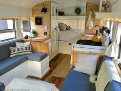 Looking good! The mobile home now boasts wooden floors, two sofas and storage, plus electricity and power sockets
