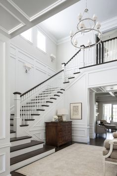 A staircase in your home can be a perfect interior symbol to bring a luxury design style. A big home with a big stair too usually is more recommended to have a luxury style on it. The staircase is als House Design, House, Home, Staircase Design, Foyer Decorating, New Homes, Foyer Staircase, White Stairs, Stairs