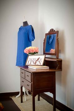 Tropic Of Linen Blue Linen dress and Guestbook on antique dressing table. Linen and Interior design. TropicOfLinen