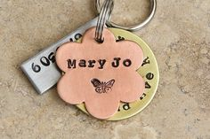"Flower 3 three piece pet tag or key chain with enough room for name, phone number, and address. Plus your choice of designer stamps. This 3 piece pet tag is perfect for the small dog because of it's small size. It measures 7/8"". We can fit up to 8 characters plus one designer stamp under name on the flower, up to 23 characters around the washer, and up to two telephone number (1 of each side) of the bar. This tag can also be used as a zipper pull for backpack or gym bag, or a key chain."