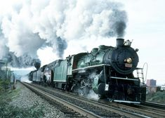 """The fantastic photo below was taken by John D. Jones at Chattanooga, TN on November 3, 1991 during the Chattanooga """"Celebration of Steam"""". Here are three mighty steam locomotives under full power. In the lead is Southern #4501, a 2-8-2 Mikado. Right behind #4501 is the famous Norfolk & Western #611 Class J streamlined locomotive and behind her is Norfolk & Western 2-6-6-4 Class A #1218. Any old railfan or hogger would be in hog heaven to see a line-up like this today (pun intended). SR 4501…"""