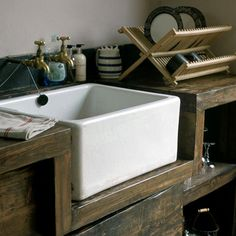 rustic farmhouse kitchen, white butler sink (nice look.that is, until the moment I accidentally swing the heavy cast iron pan against the edge of the sink. Cocina Office, Farmhouse Apron Sink, Farm Sink, Cuisines Design, Home Kitchens, Dream Kitchens, Kitchen Remodel, Kitchen Sinks, Butler Sink Kitchen