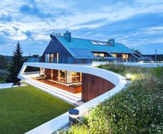 Edge House in the mountains near Krakow, Poland features a unique green-roofed terrace.  Mobius Architecture's modern twist on a traditional design shows us that green living can be beautiful, too.