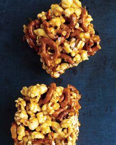 Easy make into popcorn balls for Halloween. Chewy Caramel Popcorn and Pretzel Bars - Martha Stewart Recipes Delicious Desserts, Dessert Recipes, Yummy Food, Snack Recipes, Sweet Desserts, Fun Food, Sweet Recipes, Fall Desserts, Dessert Bars