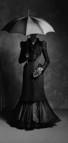 Victorian dress, umbrella* Unknown photographer