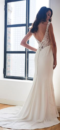 That gorgeous back though! ROXY wedding dress by Kelly Faetanini // Crepe v-neck slim gown with plunging back and embroidered appliques. @kellyfaetanini #KellyFaetanini #weddingdress #weddinggown #sponsored #wedding #bridal #blush #weddingdresses