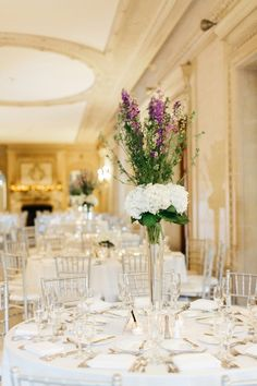 Classic white hydrangea and lavender centerpiece: http://www.stylemepretty.com/illinois-weddings/lake-forest/2016/09/29/the-reasoning-behind-this-brides-white-feather-will-make-you-cry/ Photography: Jacqui Cole - http://jacquicole.com/