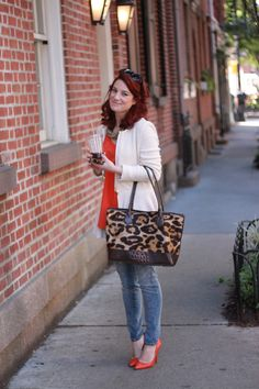 Denim, Orange, Cream - animal print in the bag - this is a terrific way for red heads to add a color without adding a color - if you know what I mean. The ensemble shows her to her best advantage - you notice the whole package not just the clothes