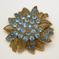 LOVE LITTLE NEMO? These charming Little Nemo brooches were very popular in the 1930's. They were usually made with multi-colored stones. It's rare to find one like this large flower, with all blue stones. Little Nemo L N Vintage Large Flower Brooch Pin Blue Rhinestones 1930s RARE, $72.95 from http://stores.ebay.com/My-Classic-Jewelry-Shop :)