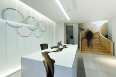 The reception desk is a standard rectangular table that is fissured with an arresting crevice that cuts deeply through the centre