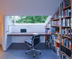 Attic studio/guest room with cardboard tube walls