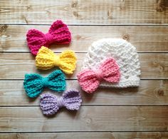 The Ashlee Beanie in White with Five Interchangeable Bows Available in Newborn to Tween Size- MADE TO ORDER by mamamegsyarnshoppe on Etsy https://www.etsy.com/listing/176929732/the-ashlee-beanie-in-white-with-five