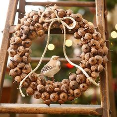 For a simple and easy-to-make holiday wreath, try this idea for an all-natural Christmas decoration. Lay a 10-inch plastic-foam flat wreath form on a protected surface, gather about 100 faux or real acorn tops and sort by size. Hot-glue the acorn tops to the wreath form, using the larger ones first and filling in the gaps with the smaller ones; let dry. Hot-glue a faux bird to the inner side of the wreath. Tie a twine bow and glue at the top of the wreath./
