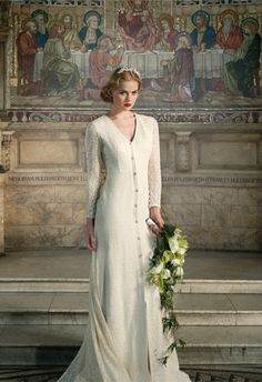 Kathryn Wedding dress  This romantic wedding gown is made of organic cotton lace with full-length sleeves and v-neckline. Fully covered with a sheer lace back and beaded broach in the centre holding the gather of the dreamy cathedral length train adds a vintage touch. SS 2013 - Wallis in Love Collection  - See more at: http://www.sanyuktashrestha.com/collection/bridal-couture/spring-summer-2013/kathryn-wedding-dress.html#sthash.TN3PoxpT.dpuf