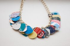 Unique necklace by Deb Kennedy. The guitar picks are made from credit cards!