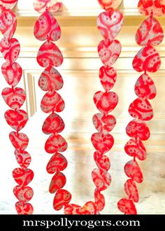Click here to DIY Dollar Tree Red Heart Garland RE-DO. Easy, quick, inexpensive!! Blog Instructions & Photos from MrsPollyRogers.com