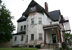 White House Apartments, Omaha - is a Victorian mansion likely built around the turn of the 20th century and in its history it has served as a private residence, a hospital and apartments. Several entities haunt the premises that are unknown as far as who they are and why they're there. They could be from its hospital days, or spectral drifters from the funeral home next door. Most reported is the apparition of a young woman in white who gives startled residents a smile before she disappears.