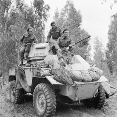 A Humber Mk II armoured car and crew of 'B' Squadron, 11th Hussars – the first vehicle to enter Tripoli, photographed on 2 February 1943.