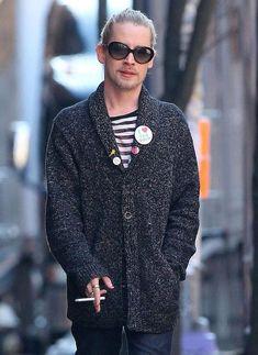 Macaulay Culkin enjoying a cigarette while roaming solo in New York City...