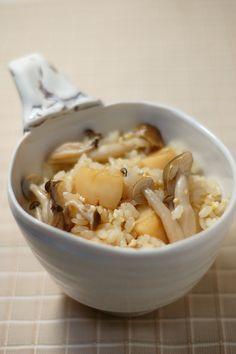 Japanese Food Takikomi Gohan, Rice seasoned with Dashi and Soy Sauce along with Scallops and Shimeji Mushrooms