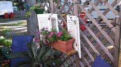 """From one of our customers....  We have a lot of all kinds of shutters at incredible prices! ==== Wanted to share the ways we repurposed the shutters to make a """"window"""" box. Also, a kitchen cabinet door and spindles made an awesome plant table. Love your shop. Keep up the good work."""
