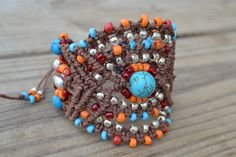 Sometime you just a little bit more color... made this brown hemp macrame bracelet using orange, turquoise, silver czech seed beads and turquoise round stones