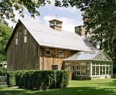 whoa. cute barn plus greenhouse. guess its been converted into a house! well a guest house on a big estate.