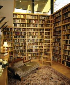 24 Amazing Walls of Books. Take a page from wall-high shelves for books remembered, and yet to read. Personally, I could move in to any one of these spaces!!!