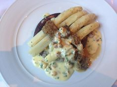 Lunch at The Gilbert Scott in the St Pancras Hotel. dish of white asparagus, Cheddar pancake, morels, and hazelnuts