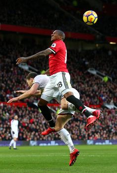 Ashley Young of Manchester United wins a header during the Premier League match between Manchester United and Burnley at Old Trafford on December 26...