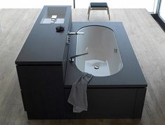 Compact Bathrooms Shower Sink ComboA sink, a tub and built-in storage come together in one simple black unit. The 'Be Yourself' collection by Sieger Design for Alape can be customized with various fixtures and finishes