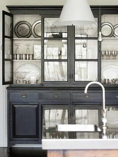 Black painted hutch with white interior. Very elegant! #home #decor