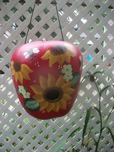 A beautiful apple gourd with sunflowers