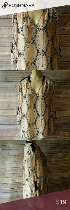Printed Sheer Blouse Size Large Cute v-neck printed sheer blouse. Has roll tab sleeves but the sleeves can also be unrolled. Has black, off white & peach colors. Would look great with jeans or slacks.   Size Large 100% Polyester Love 21 Tops Blouses