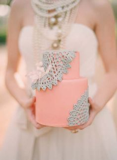 The pink is so charming, but what I'm really interested in is the menagerie of necklaces on the bride!
