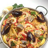 Cuban Paella | A very traditional Cuban dish and originally from Spain, this dish is a seafood paradise, including the best ingredients which give it a very zestful taste. It is very time consuming, and takes several hours to cook, but the results are well worth it!