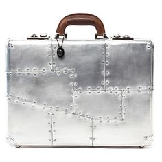 You won't need a luggage tag or a red ribbon to identify your bag on the carousel if you're toting a one-of-a-kind hardcase from London-based furniture reproductionist Timothy Oulton. His inspired, aluminum-clad cases come in four different sizes.