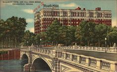 Meridian Street Bridge over Fall Creek, Indianapolis with the Marott Apartments in background.