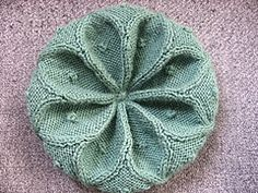 Ravelry: Cabled Rangoli Hat pattern by Desi Knitter