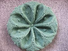 Ravelry: Cabled Rangoli Hat pattern by Desi Knitter