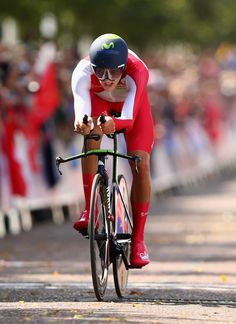 GLASGOW, SCOTLAND - JULY Alex Dowsett of England crosses the finish line during the Men's Cycling Road Time Trial at during day eight of the Glasgow 2014 Commonwealth Games on July 2014 in Glasgow, United Kingdom. (Photo by Ryan Pierse/Getty Images) Alex Dowsett, Men's Cycling, Commonwealth Games, Glasgow Scotland, July 31, Finish Line, Crosses, The Man, United Kingdom