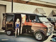 Woman and her Classic Dodge Van.I love seeing a Lady roll up to a festival in a cool van!