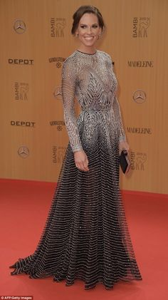 Glam: Hilary Swank wowed in a glitzy floor-length number as she picked up a prize at Berlin's  Bambi Awards on Thursday evening