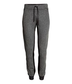 Sports sweatpants in grey with contrasting details. Elasticized drawstring waistband, mesh-lined side pockets, and back pocket with zip. Tapered legs with seams at knees and elastication at hems. | H&M Sport
