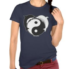 "Yin Yang Dolphins Black/White Tees The dolphin meaning is connected with themes of duality. It has to do with the dolphin being both fish and mammal. It is both of the water, and an air breather. Ergo, dolphin symbolism talks to us about ""being in two worlds at once."" Indeed, the dolphin is a great conveyor of the concept of yin and yang. The image of two dolphins together is symbolic of harmony within the Chinese yin-yang philosophy."