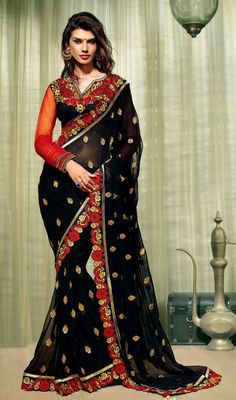 Look gorgeous draping this navy blue embroidered georgette saree. The stunning gold zardosi, lace, resham, stones and unique border work all through saree is awe-inspiring. #GorgeousTrendsetterSaree