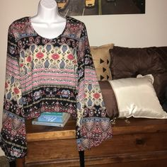 Paisley Boho Top Oversized fit and cropped in the front. Longer fit at the back. Sleeves flare out and have fringe. Tops Blouses