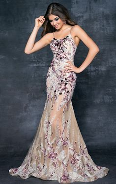 Sherri Hill Dresses. This dress is a mermaid style gown with sheer fabric at the bottom. Beaded from head to toe!