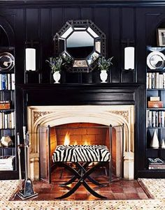 Dark walls (lacquered black in this case) can make for wonderfully cozy rooms. This one by Nancy Boszhardt from House Beautiful